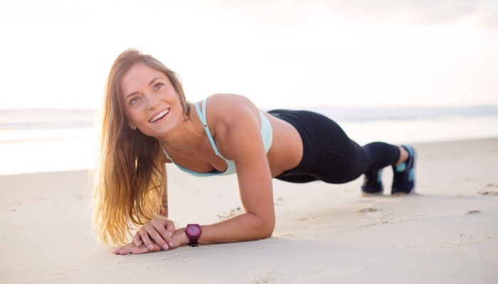fit woman doing exercise outside